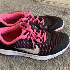 This is a pink and black tennis shoes